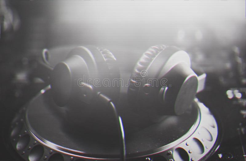 DJ headphones on CD music player stock photos