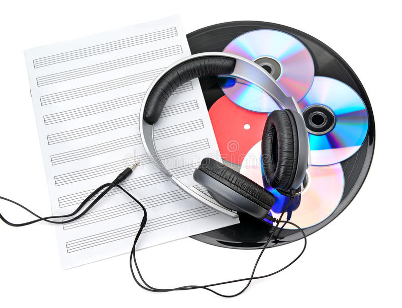 Headphones, CDs and vinyl records royalty free stock images