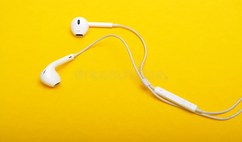 Headphones closeup on Yellow Background royalty free stock photo
