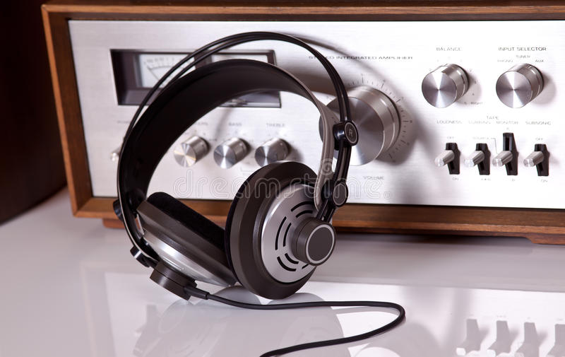 Headphones connected to vintage audio stereo stock photo