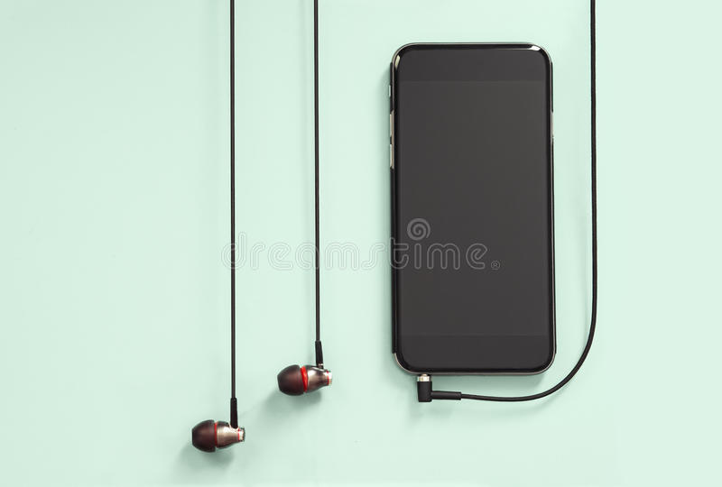 Headphones with Device. Headphones and Device on Colored Background stock photos
