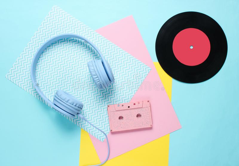 Headphones and earphones with audio cassettes royalty free stock image