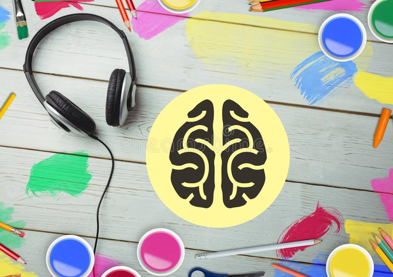 Headphones and heart shape on wooden table with color pencils and paint stock photos