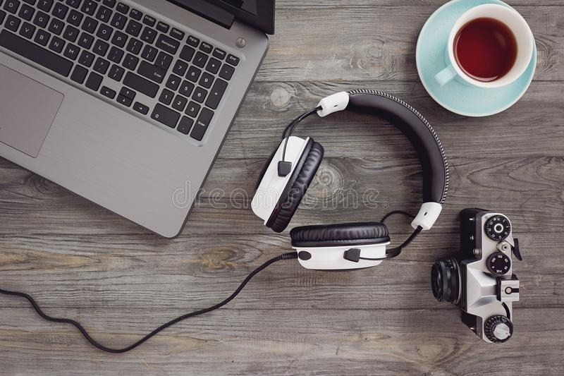 Headphones and laptop on table royalty free stock photo