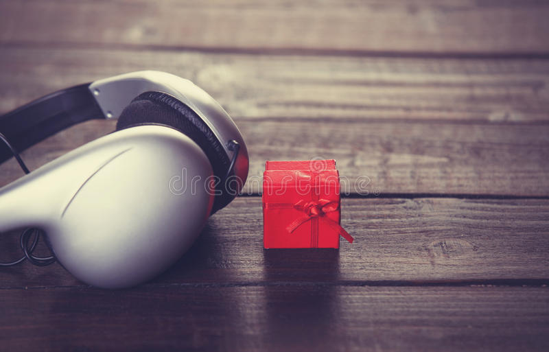 Headphones and little gift royalty free stock photos