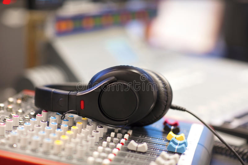 Headphones on Mixer Cord In Radio Studio stock images