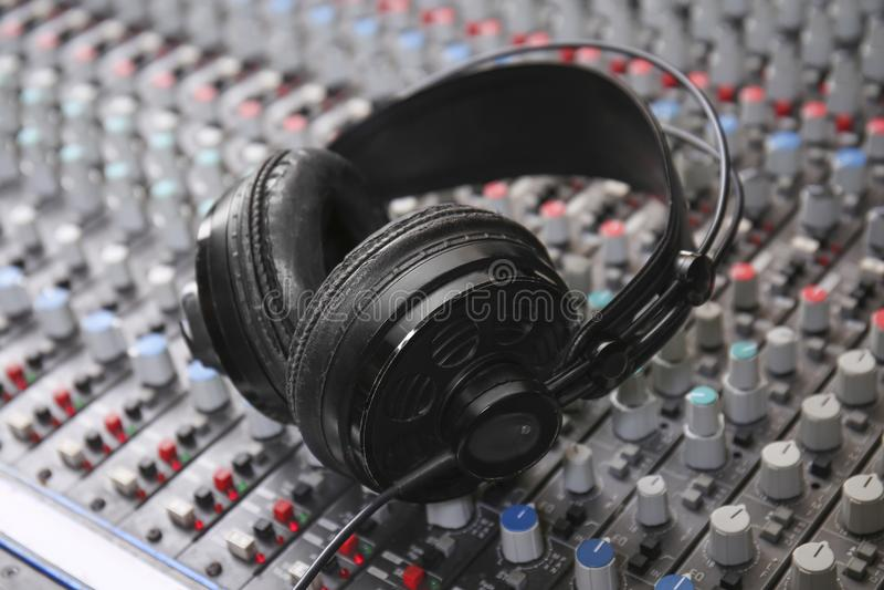 Headphones on mixer. In radio station royalty free stock photo