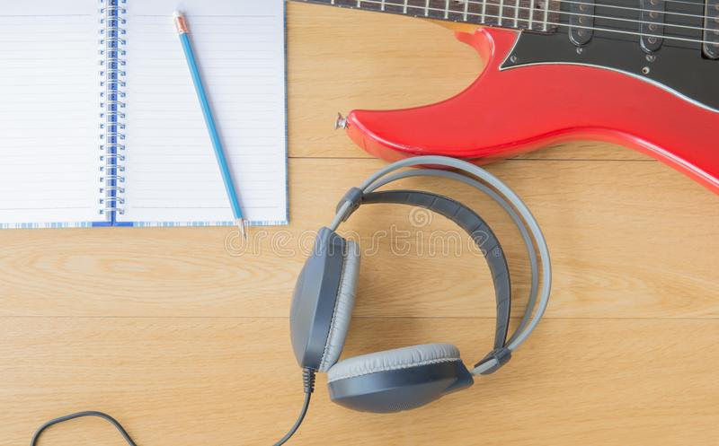 Headphones and notebook computers. On wood royalty free stock images