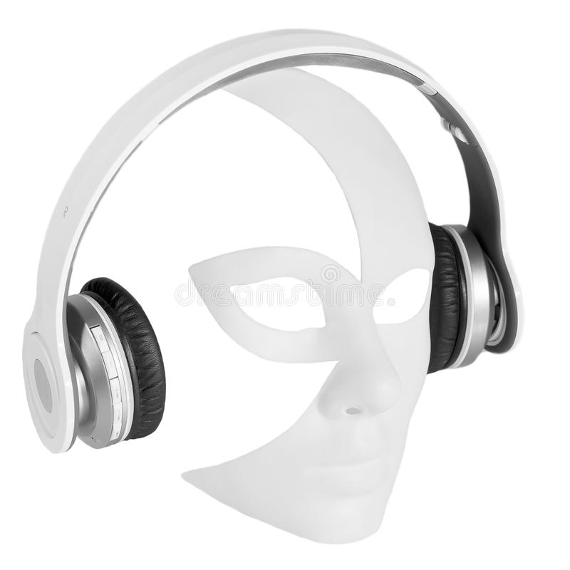 Headphones player carnival mask stock image
