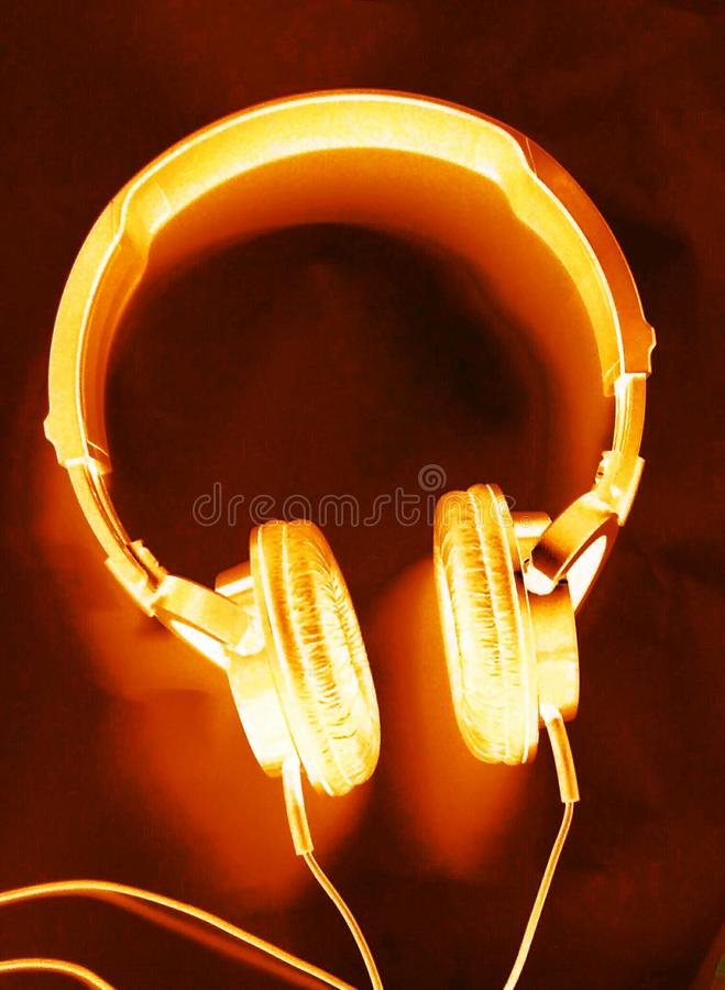 Headphones. Red burning headphones with heavy bass rock music royalty free stock photo
