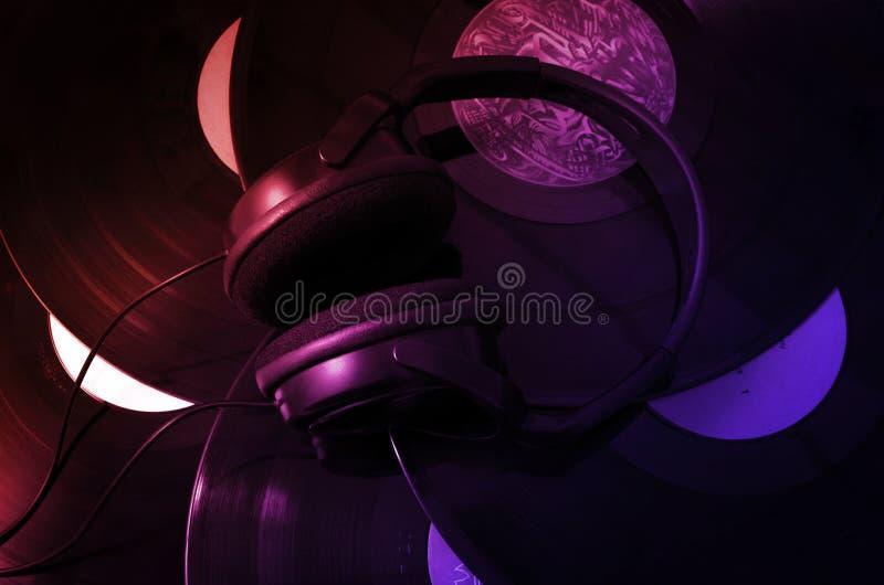 Headphones and vinyl records stock image