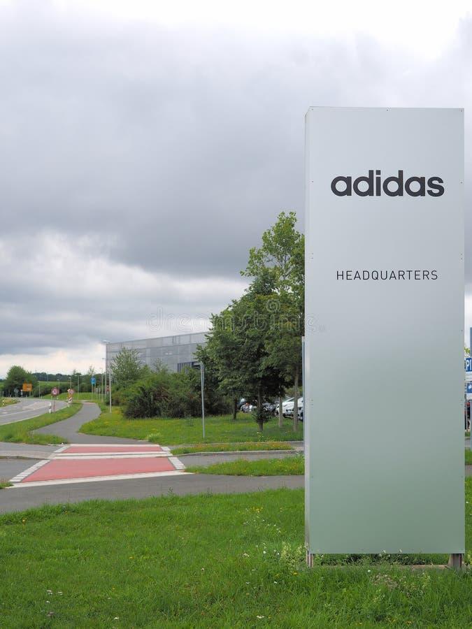 Herzogenaurach, Germany - August 19, 2019: Headquarter sign of global sports brand Adidas. Headquarter sign of global sports brand Adidas in the village of stock photos