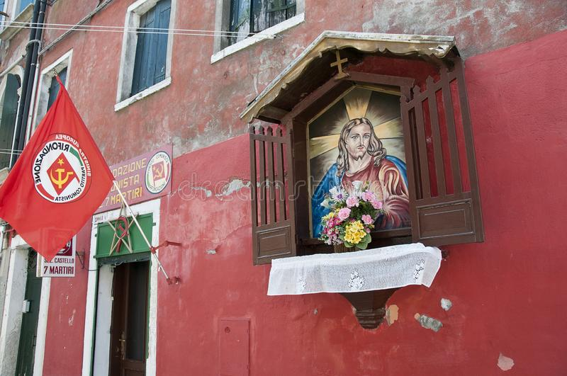 Headquarters of communist party and image of Jesus Christ, Venice, Italy royalty free stock photos