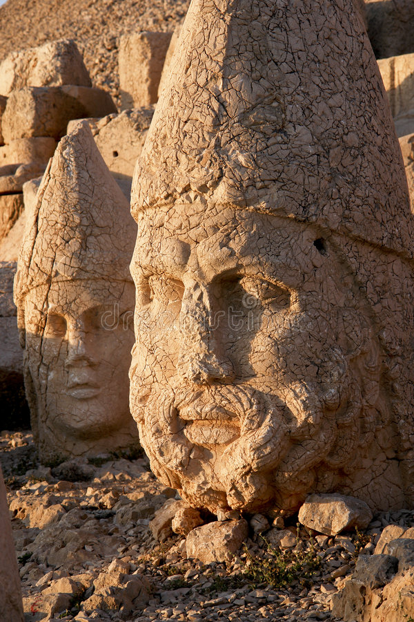 Heads of the colossal statues on Mount Nemrut. In Turkey stock photography