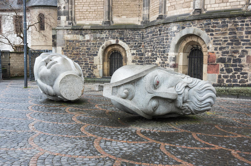 The heads of Saints Cassius and Florentius. Sculptures depicting the heads of Saints Cassius and Florentius in front of the Bonn Minster, Bonn, Germany stock photos