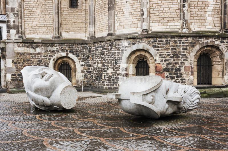 The heads of Saints Cassius and Florentius. Sculptures depicting the heads of Saints Cassius and Florentius in front of the Bonn Minster, Bonn, Germany stock image
