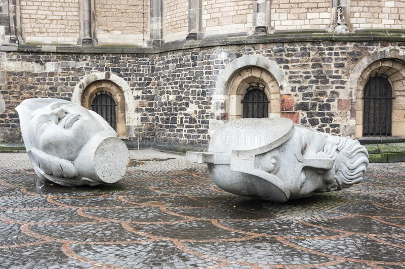 The heads of Saints Cassius and Florentius. Sculptures depicting the heads of Saints Cassius and Florentius in front of the Bonn Minster, Bonn, Germany royalty free stock photo