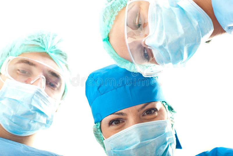 Heads of surgeons in operation