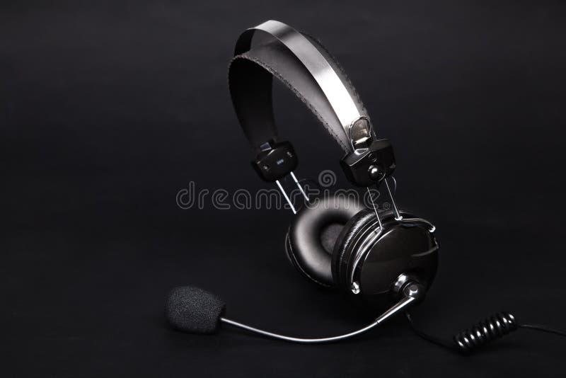 Headset on black background royalty free stock image