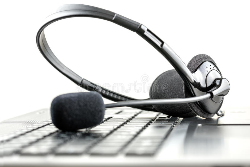 Headset on a laptop computer. Headset lying on a laptop computer keyboard conceptual of telemarketing, call center, client services or online support