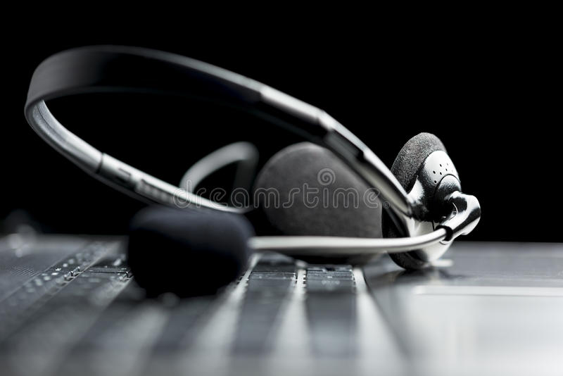 Headset lying on a laptop computer keyboardHeadset lying on a la stock images