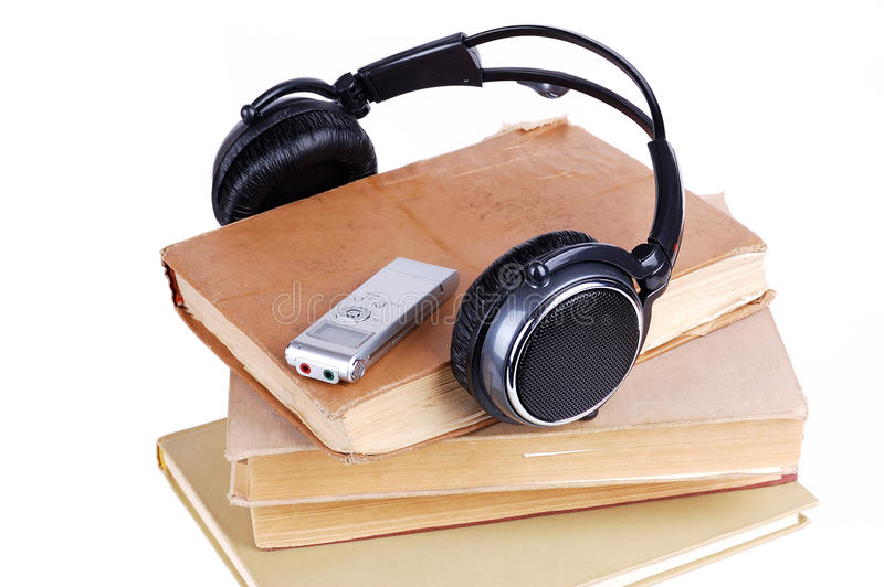 Headsets. On the pile of books stock photography