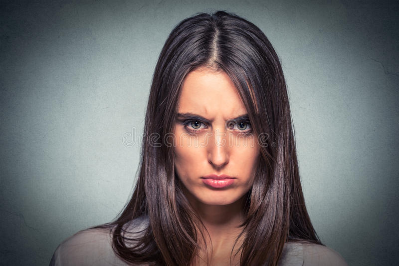 Headshot of an angry woman. Headshot of an angry young woman royalty free stock photography