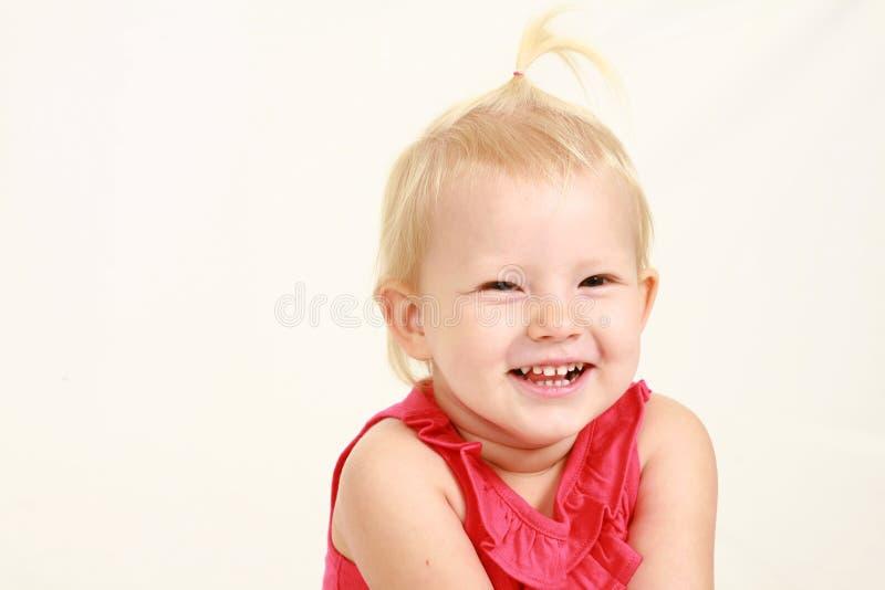 Headshot av den blonda litet barnflickan royaltyfri foto