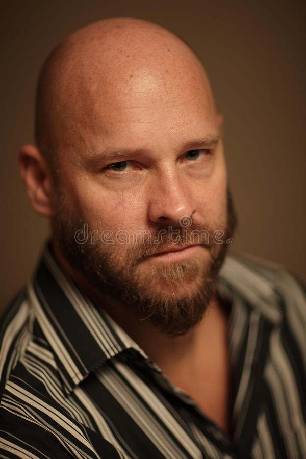 Headshot of a bald man. Image of a handsome bald man royalty free stock photography