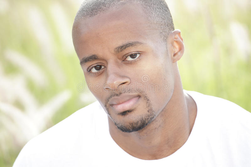 Headshot of a black man. Headshot of a handsome African American male royalty free stock photos