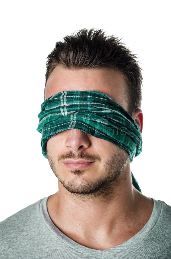 Headshot of blindfolded young man isolated on white royalty free stock images