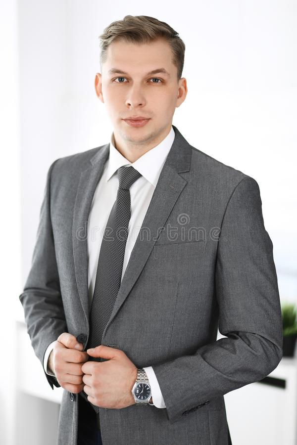 Headshot of businessman standing straight in office. Success and business workplace concept royalty free stock photography