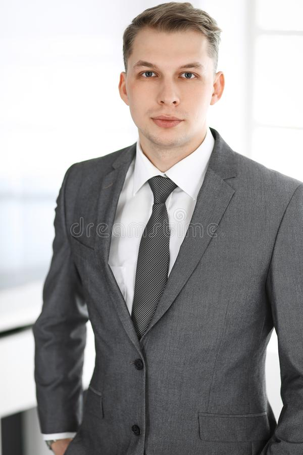 Headshot of businessman standing straight in office. Success and business workplace concept stock photo