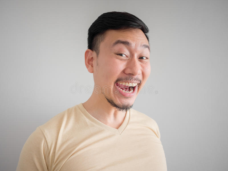 Headshot of crazy laughing Asian man. stock image