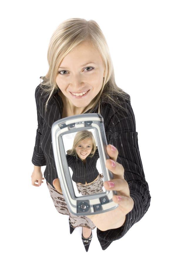 Headshot da mulher loura nova com palmtop imagens de stock royalty free