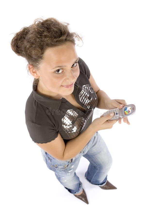 Headshot de la mujer joven con el teléfono móvil imagenes de archivo