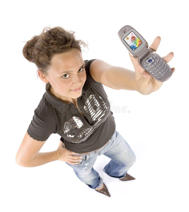 Headshot de la mujer joven con el teléfono móvil imagen de archivo libre de regalías