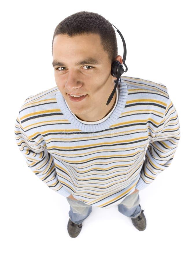 Headshot dell'uomo con la cuffia avricolare del telefono fotografia stock libera da diritti