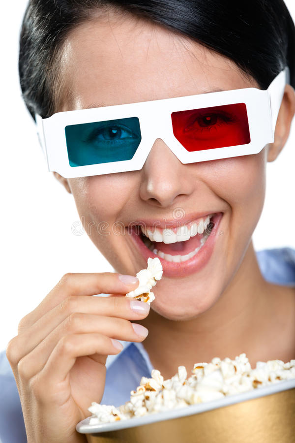 Headshot of the girl in 3D glasses eating popcorn royalty free stock photo