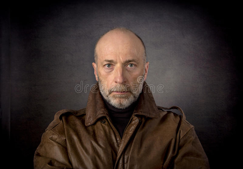 Headshot of man in leather jacket royalty free stock images