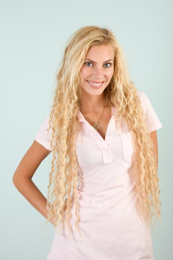 Headshot portrait of beautiful young blond woman