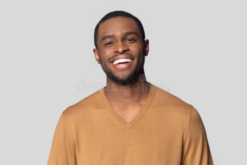 Headshot portrait of black man posing in studio stock photography