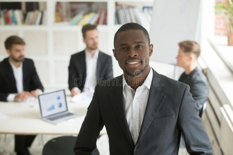 Handsome smiling african american businessman looking at camera. royalty free stock images