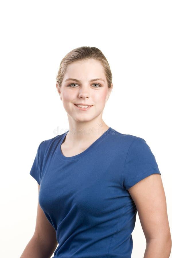 Headshot portrait of teenage girl in blue blouse stock photo