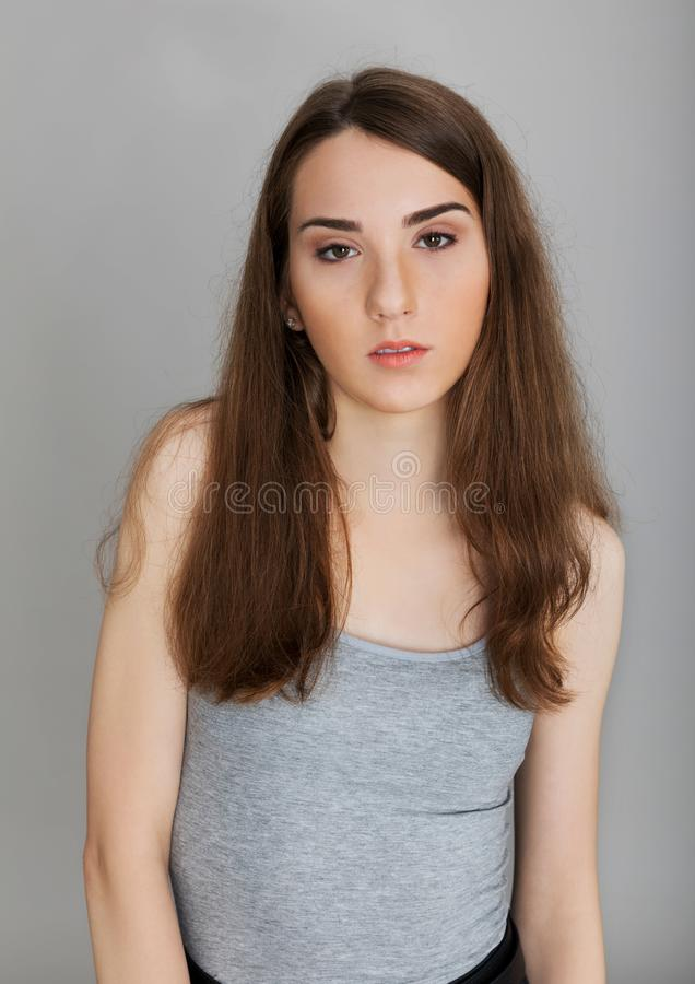 Young teenager girl. Headshot portrait of young girl on white background royalty free stock photo