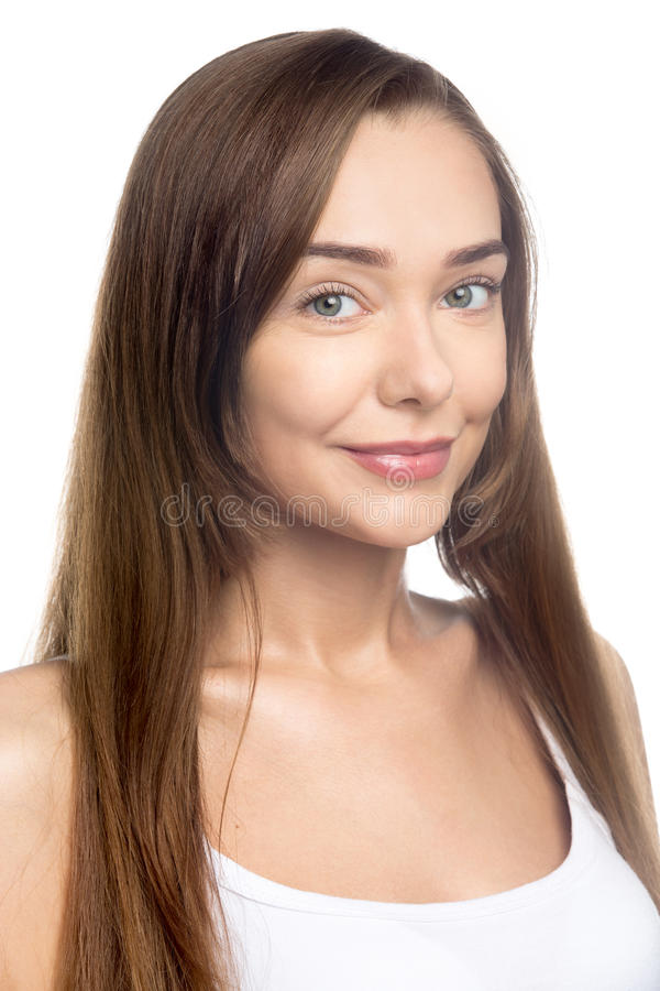 Headshot portrait of young smiling woman in studio. Portrait of happy beautiful attractive Caucasian young woman with long hair posing against white background stock photos