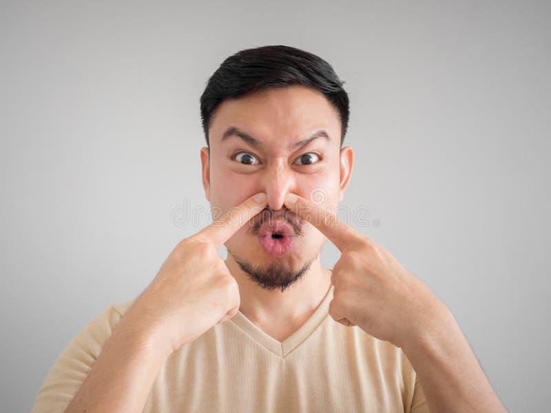 Headshot of smell something bad face of Asian man. stock image