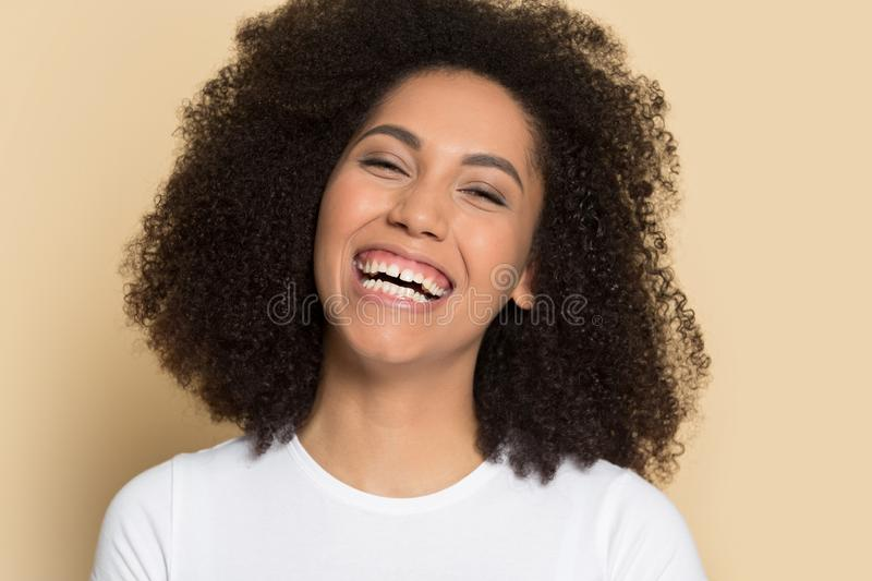 Headshot of smiling african American girl posing in studio stock photography