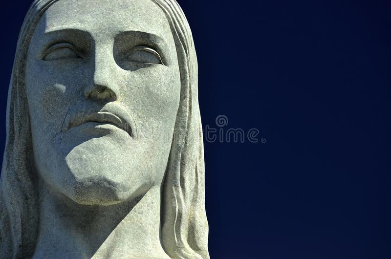 Headshot of the statue Christ the Redeemer is an Art Deco statue in Rio de Janeiro stock photo