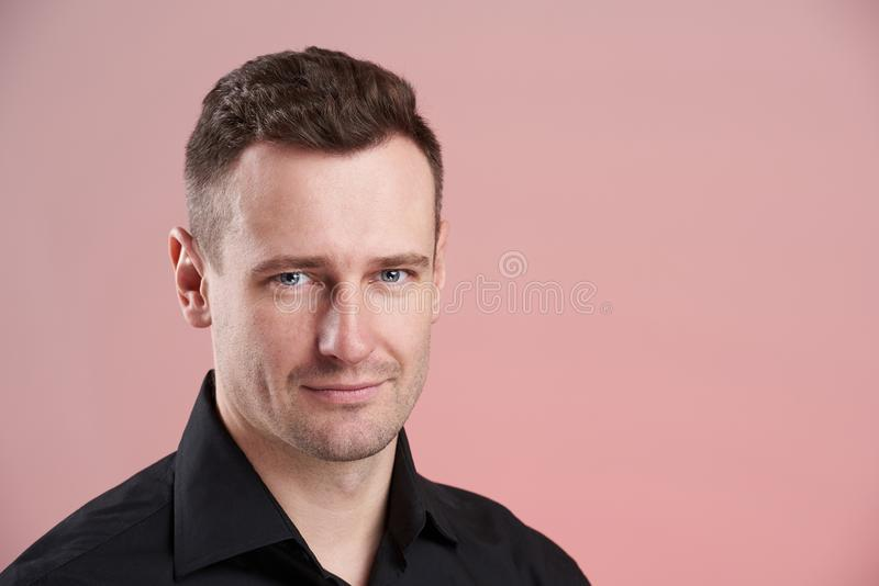 Headshot of young serious man stock images